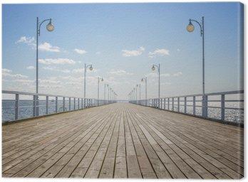 Canvas Oude lege houten pier over de kust met een kopie ruimte