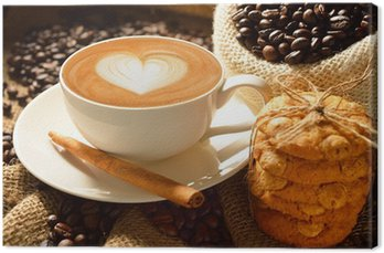 Canvas Print A cup of cafe latte with coffee beans and cookies