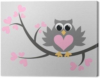 a grey owl sitting in a tree Canvas Print