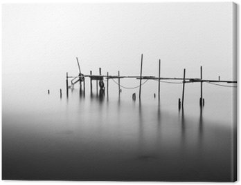 Canvas Print A Long Exposure of an ruined Pier in the Middle of the Sea.Processed in B&W.