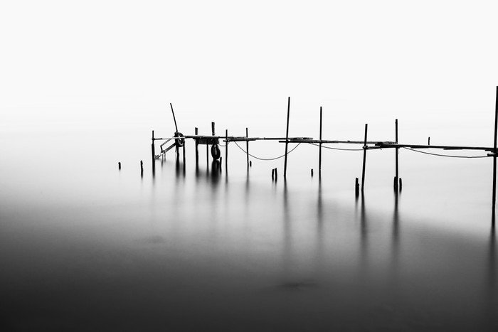 A Long Exposure of an ruined Pier in the Middle of the Sea.Processed in B&W.