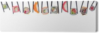A lot of sushi and rolls in black chopsticks isolated on white background Canvas Print