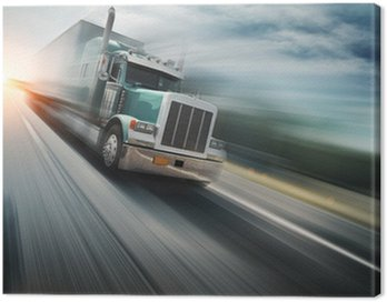 Canvas Print American truck speeding on freeway. Blurred motion.