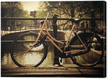 Amsterdam. Romantic canal bridge, bike