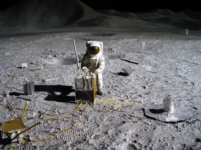 Canvas Print astronaut collecting lunar artifacts - Outer Space
