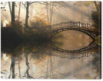 Autumn - Old bridge in autumn misty park Canvas Print