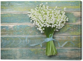 Canvas Print Beautiful bouquet of flowers lily of the valley on vintage wooden table from above, rustic background