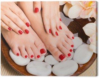 Beautiful female feet at spa salon on pedicure procedure Canvas Print