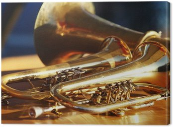 Canvas Print Blowing brass wind instrument on table