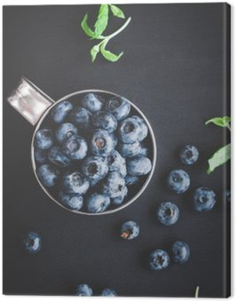 Blueberry on black background. Top view, flat lay
