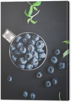 Canvas Print Blueberry on black background. Top view, flat lay