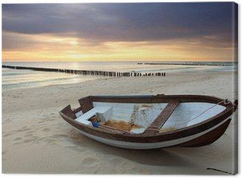 Boat on beautiful beach in sunrise Canvas Print