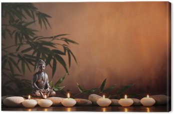 Buddha with burning candle and bamboo