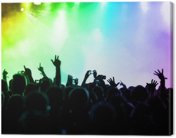 Canvas Print cheering crowd in front of colorful stage lights