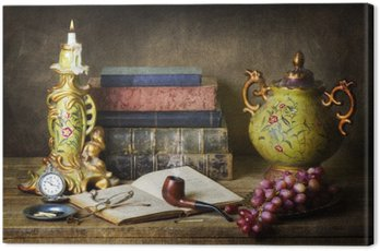 Classic still life with antiques,vintage books,old pipe, glasses,pocket watch and grapes on rustic wooden table.