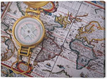 Compass and vintage map on a wooden table.