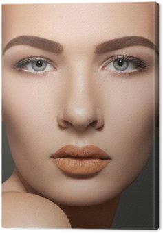 Cosmetics. Clean skin, eyebrows, sexy lips makeup on model face Canvas Print