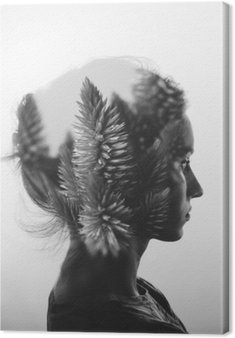 Creative double exposure with portrait of young girl and flowers, monochrome Canvas Print