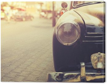 Canvas Print Detail of headlight lamp classic car parked in urban - vintage filter effect style