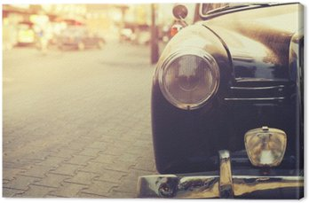 Detail of headlight lamp classic car parked in urban - vintage filter effect style Canvas Print