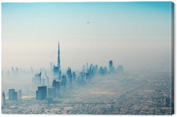 Canvas Print Dubai city in sunrise aerial view