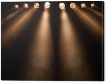 Eight divergent spotlights at night