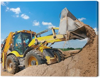 Canvas Print Excavator machine unloading sand during earth moving works