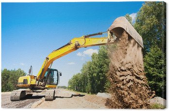 Canvas Print Excavator unloading sand during road construction works