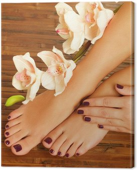 female feet at spa salon on pedicure procedure Canvas Print