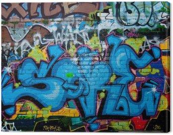 Canvas Print Graffiti detail on the textured brick wall