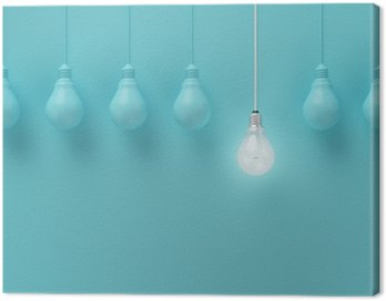 Canvas Print Hanging light bulbs with glowing one different idea on light blue background , Minimal concept idea , flat lay , top