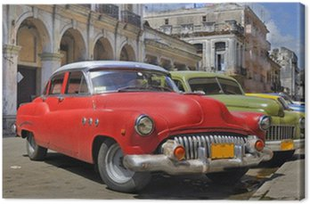 Canvas Print Havana street with colorful old cars in a raw