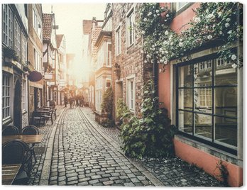 Historic street in Europe at sunset with retro vintage effect