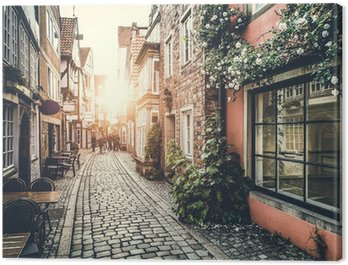 Canvas Print Historic street in Europe at sunset with retro vintage effect