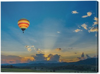 Canvas Print Hot air balloon over the fields at sunset