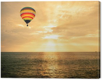 Canvas Print Hot air balloon over the sea at sunset