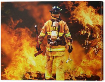 Canvas Print In to the fire, a Firefighter searches for possible survivors