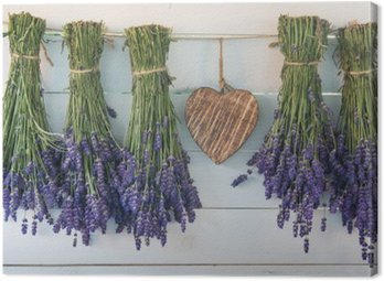 Canvas Print Lavender and wooden heart on the background of the old boards