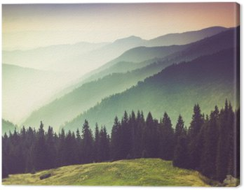 Layers of mountain and haze in the valleys.