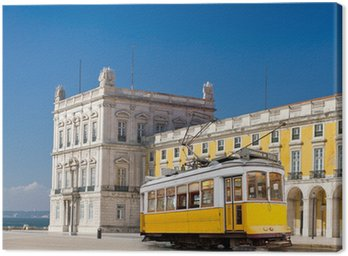 Canvas Print Lisbon yellow tram at central square Praca de Comercio, Portugal