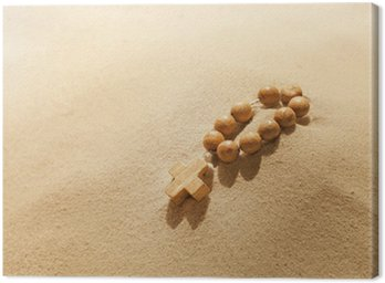 Losing faith rosary on desert religion symbol metaphor