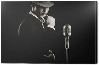 Canvas Print low key portrait of jazz singer in hat in the darkness.