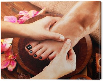 Massage of woman's foot in spa salon Canvas Print