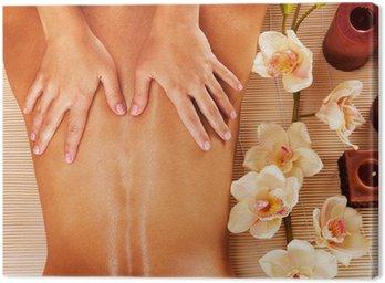 Masseur doing massage on woman back in spa salon Canvas Print