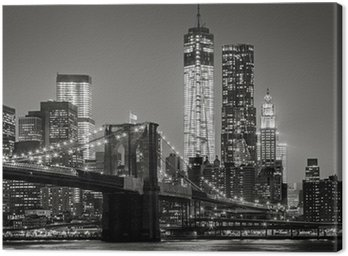 New York by night. Brooklyn Bridge, Lower Manhattan – Black an Canvas Print