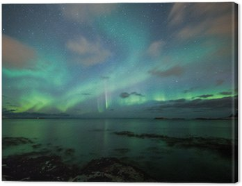 Northern lights above a beach in Norway