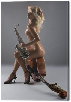Nude woman with saxophone sitting on an old contrabass