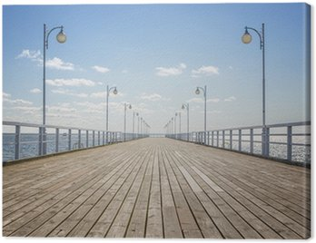 Canvas Print Old empty wooden pier over the sea shore with copy space