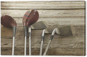 Canvas Print Old golf clubs on rough wood surface
