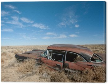 Canvas Print Old rusted car in the middle of New Mexico desert